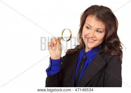Portrait of a business woman looking through a magnifying glass. Isolated over white.