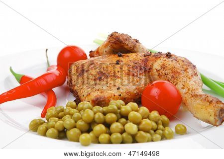 meat savory : chicken legs  grilled and garnished with green onion and red chili hot pepper on white plate isolated over white background