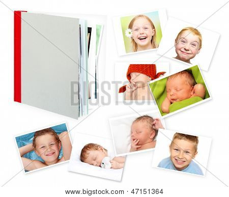Photo album, book and photos against a white background