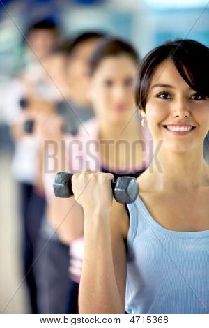 Girl Lifting Small Freeweights