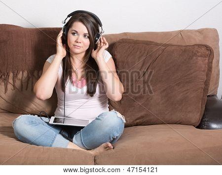 Smiling happy young woman with headphones