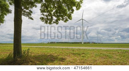 Windmill and tree in the countryside