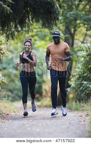Couple jogging on gravel path