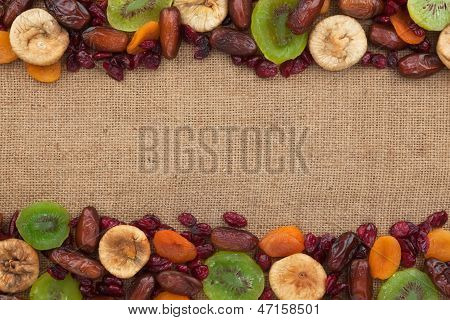 Mixture Of Dried Fruits Lying On Sackcloth