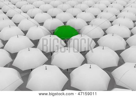 Green umbrella among other white umbrellas