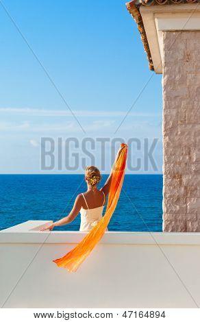 Beautiful Elegant Woman In White Dress Greeting Somebody