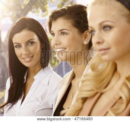 Outdoor portrait of attractive businesswomen. Selective focus.