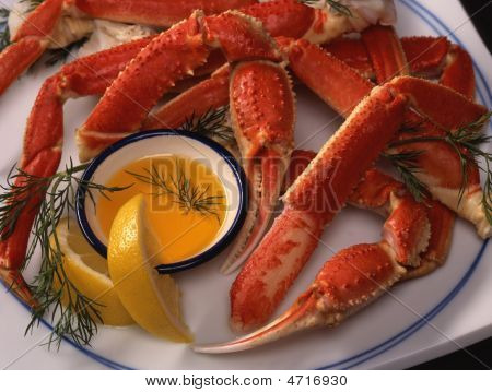 Platter Of King Crab Legs With Butter And Lemon