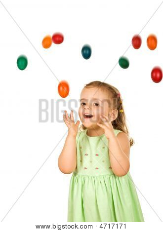 Happy Surprised Little Girl With Falling Easter Eggs