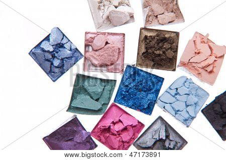 multicolored crushed eyeshadows isolated on white background