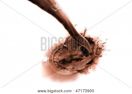 pouring chocolate drink, isolated on white background