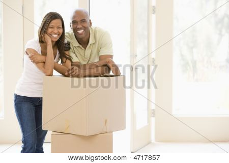 mit Boxes in new home smiling couple