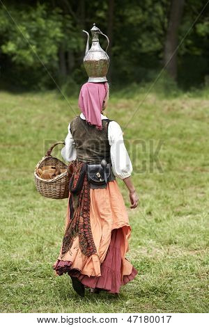 Woman carrying a pot on her head