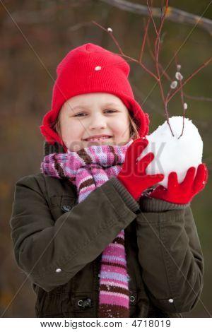 Litle Girl Making Snowballs