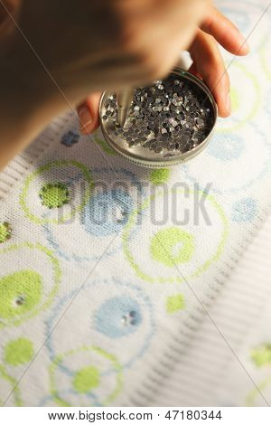 Image of gluing sequins to tissue