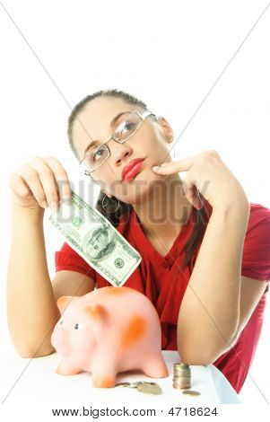 Yougn Woman With A Piggy Bank