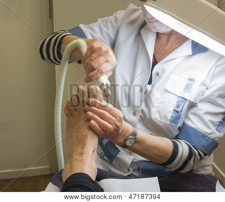 Treating Foot By Pedicure
