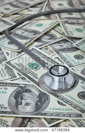Stethoscope with U.S. dollar banknotes