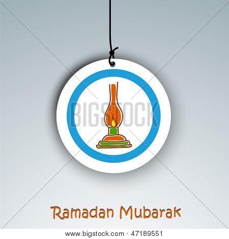 Holy month of Muslim community Ramadan Kareem background with illuminated tradition lantern on hanging tag or label.