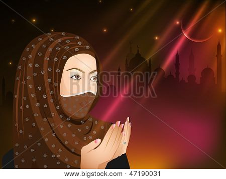 Young Muslim girl in traditional dress praying (reading Namaz, Islamic prayer) on abstract shiny background.