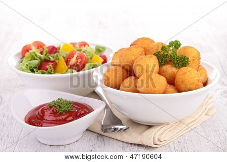 dauphine potato and ketchup