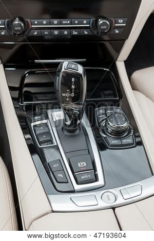 automatic gear shifter in black dashboard inside sports luxury car