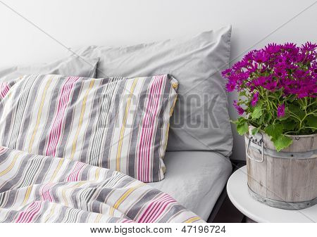 Bedroom Decorated With Bright Purple Flowers