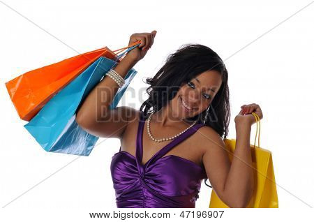Young Black woman with shopping bags sand smiling isolated on a white background