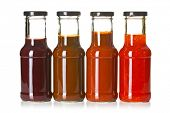 stock photo of barbecue grill  - the various barbecue sauces in glass bottles - JPG