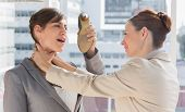 image of strangled  - Businesswoman defending herself from her colleague strangling her in a bright office - JPG