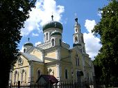 foto of deacon  - image of beautiful church on a background of the blue sky - JPG