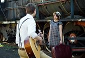 stock photo of serenade  - Retro hip hipster romantic love couple serenade vintage train setting