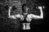stock photo of barbell  - strong woman is training with barbells - JPG