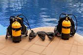 stock photo of flipper  - aqualung and flippers near the pool - JPG