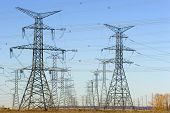 stock photo of power lines  - rows of electrical towers - JPG