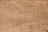 stock photo of sackcloth  - The two horizontal stitching on the burlap as background - JPG
