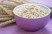 stock photo of oats  - bowl full of oats  - JPG