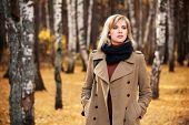 image of lonely woman  - Blond woman walking in autumn forest - JPG