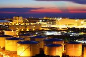 stock photo of terminator  - Oil tank in cargo service terminal at night - JPG