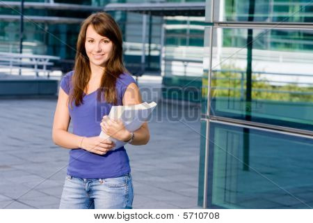 Pretty Caucasian Girl Standing In School
