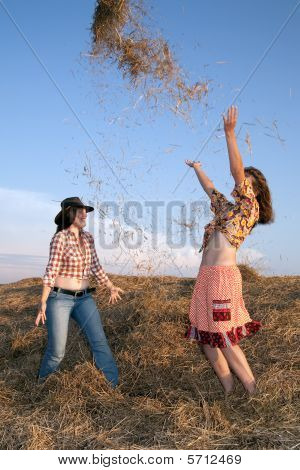 Playing Girls  In Hay