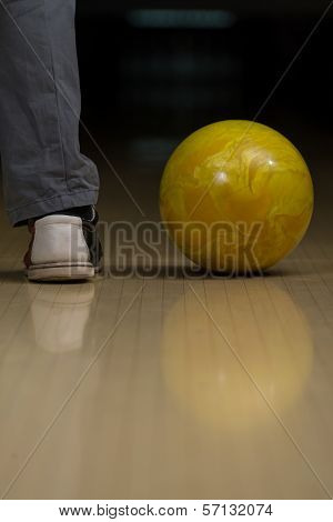 Bowling Ball Next To The Foot