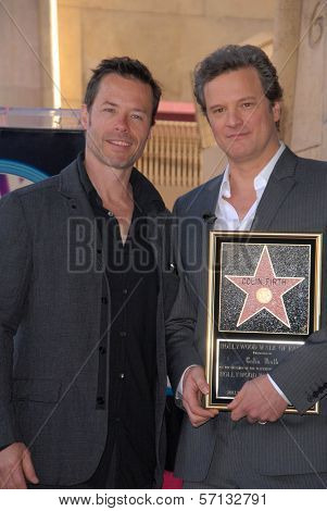Guy Pearce and Colin Firth at the indiction ceremony for Colin Firth into the Hollywood Walk of Fame, Hollywood, CA. 01-13-11