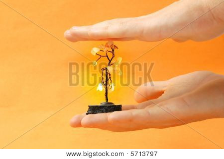 Hand With Artificial Metal Tree