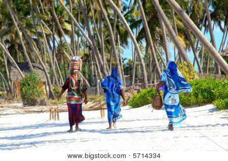 Zanzibar women on sandy beach