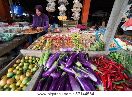 Indonesian Woman Selling Vegetables In The Market At Timika.