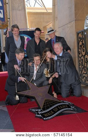 Colin Firth, Livia Giuggioli, Guy Pearce, Leron Gubler at the indiction ceremony for Colin Firth into the Hollywood Walk of Fame, Hollywood, CA. 01-13-11