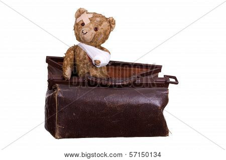 Old Sick Teddybear On Suitcase