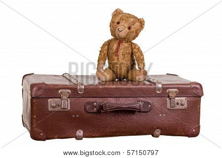 Old Teddybear Sitting On Suitcase
