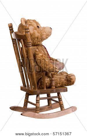 Old Teddybear On Wooden Chair